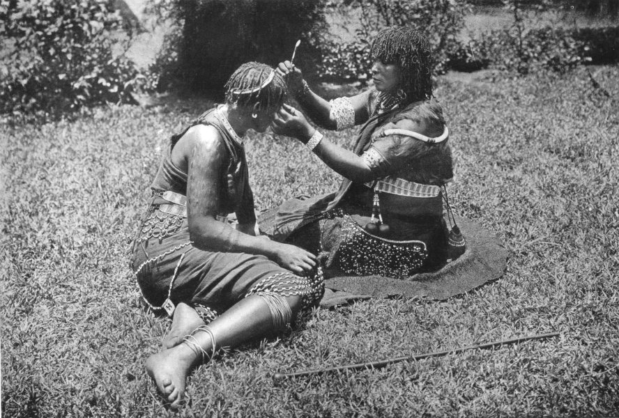 SOUTH AFRICA. Zulu women at their toilet; braiding hair 1900 old antique print