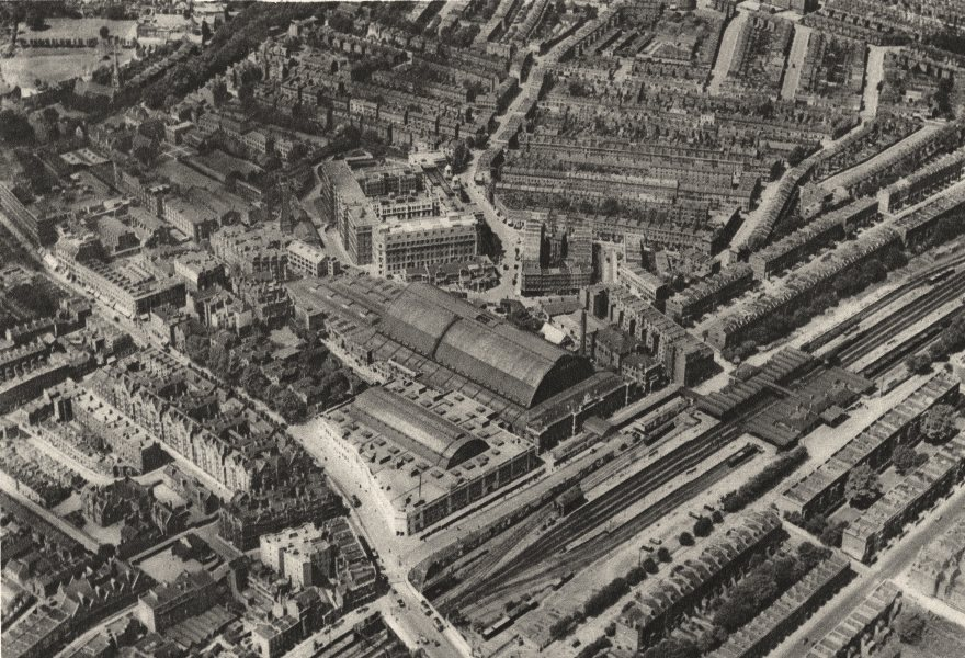 Associate Product LONDON. Over Olympia and the headquarters of the Post Office savings bank 1926