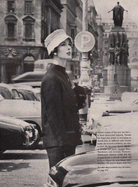 Associate Product Black honeycomb hopsack suit. White felt Rudolf hat. Fashion. BRITISH VOGUE 1955