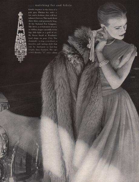 Associate Product Matching fur & fabric. Pale grey Platina fox stole. Fashion. BRITISH VOGUE 1955