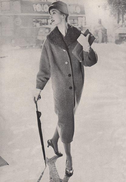 Associate Product Women's fashion. Umbrella. Coat. Hat. Double-decker bus.. BRITISH VOGUE 1955